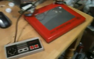 NES controller connected to Etch-a-Sketch