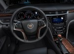 Cadillac CUE integrates interior design with industry-first control and command technologies. It will debut in 2012 in the ATS and XTS luxury sedans and SRX luxury crossover. Shown are the fully reconfigurable gauge cluster, heads-up display, steering wheel controls and capacitive touch main screen.