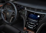 Cadillac CUE integrates interior design with industry-first control and command technologies. It will debut in 2012 in the ATS and XTS luxury sedans and SRX luxury crossover, and features a 1.8 liter storage compartment behind the main system touch screen. The compartment features USB, power and wireless Bluetooth connections for devices and smartphones.