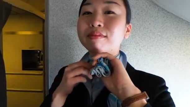 Tying a neck scarf on Geek Beat Vlog 29